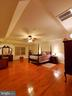 Primary MBR suite with tray ceiling & lighted fan. - 4152 AGENCY LOOP, TRIANGLE
