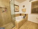 Soaking tub with luxurious tile surround & floor. - 4152 AGENCY LOOP, TRIANGLE