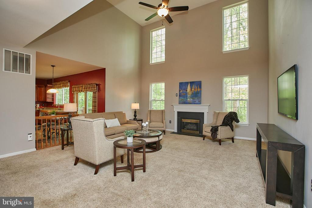 2 story family room with gas fireplace - 9216 ZACHARY CT, MANASSAS PARK