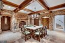 Wine tasting room with brick floors and fireplace - 12410 COVE LN, HUME