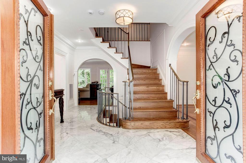 Double doors open to foyer - 3115 NORMANSTONE TER NW, WASHINGTON