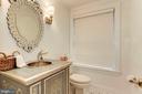 Half bathroom on main floor - 3115 NORMANSTONE TER NW, WASHINGTON