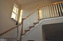 Entry foyer with open staircase to upper level. - 1503 S OAKLAND ST, ARLINGTON