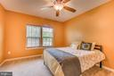 Main level bedroom with ceiling fan - 31 LIBERTY KNOLLS DR, STAFFORD