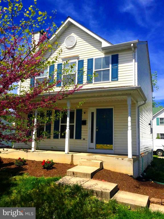Front porch with blooming cherry tree - 1001 MONTGOMERY ST, LAUREL
