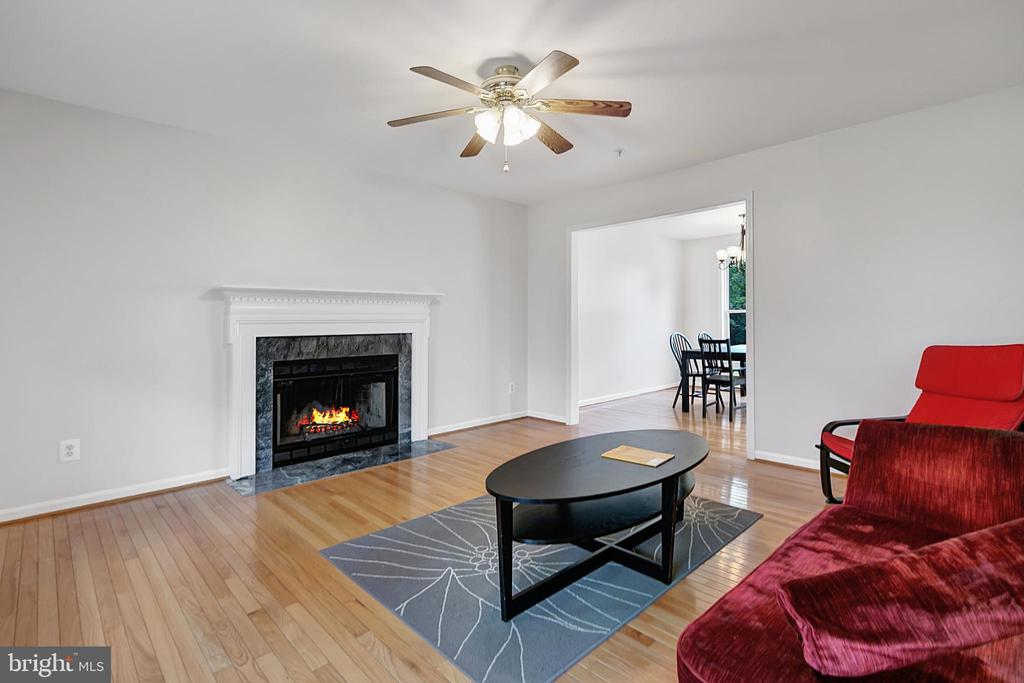 Living room with fireplace and wood mantle - 1001 MONTGOMERY ST, LAUREL