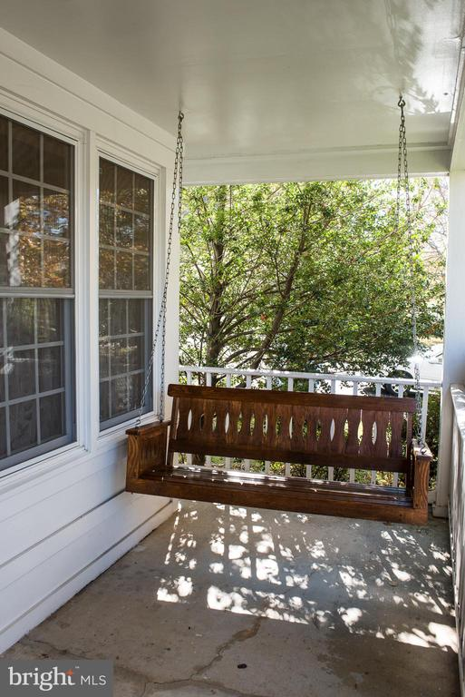 Relaxing front porch swing - 14069 SADDLEVIEW DR NW, NORTH POTOMAC