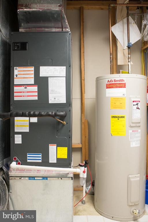 Utility area, newer heat pump/water heater - 14069 SADDLEVIEW DR NW, NORTH POTOMAC