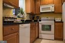 Kitchen with pass thru window - 14069 SADDLEVIEW DR NW, NORTH POTOMAC