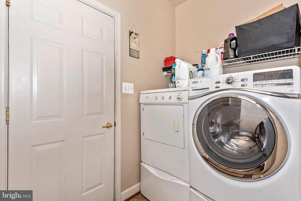Main level laundry, door to garage - 1808 GREYSENS FERRY CT, POINT OF ROCKS