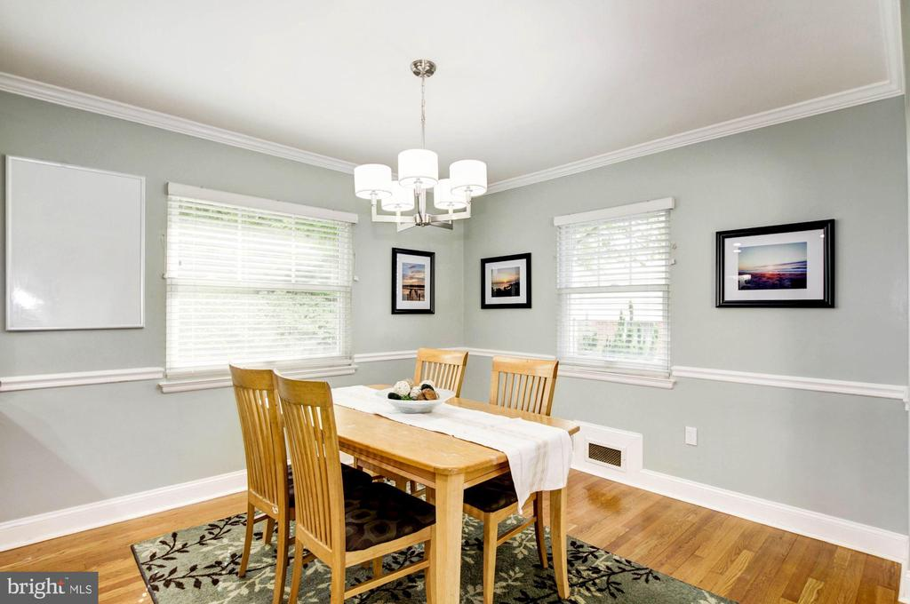 Dining room with chair rail and crown molding - 3103 CREST AVE, CHEVERLY
