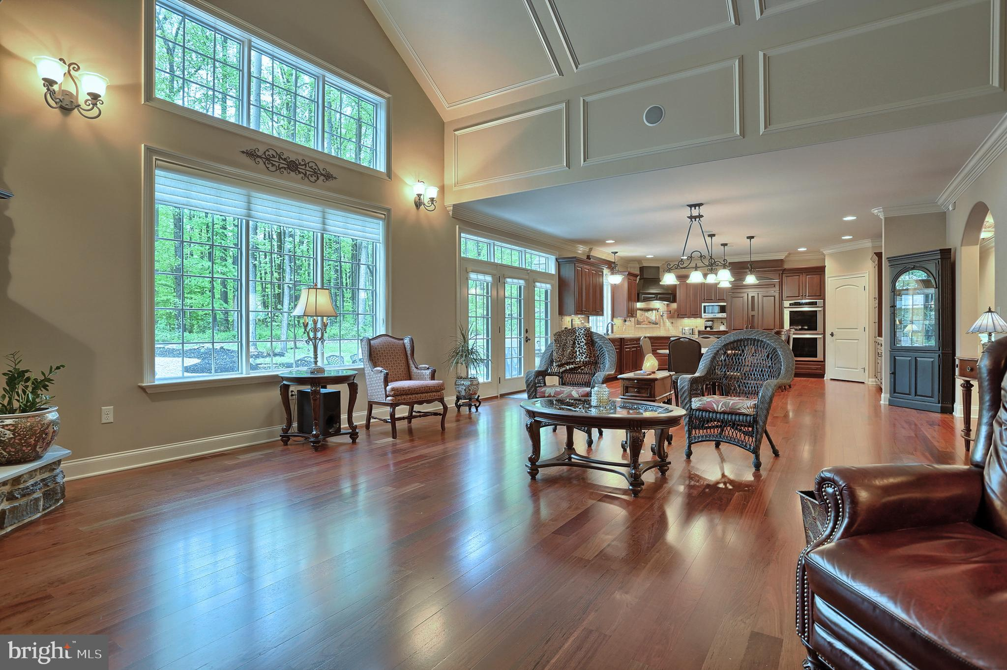 Natural light  embraced by tall windows w transom