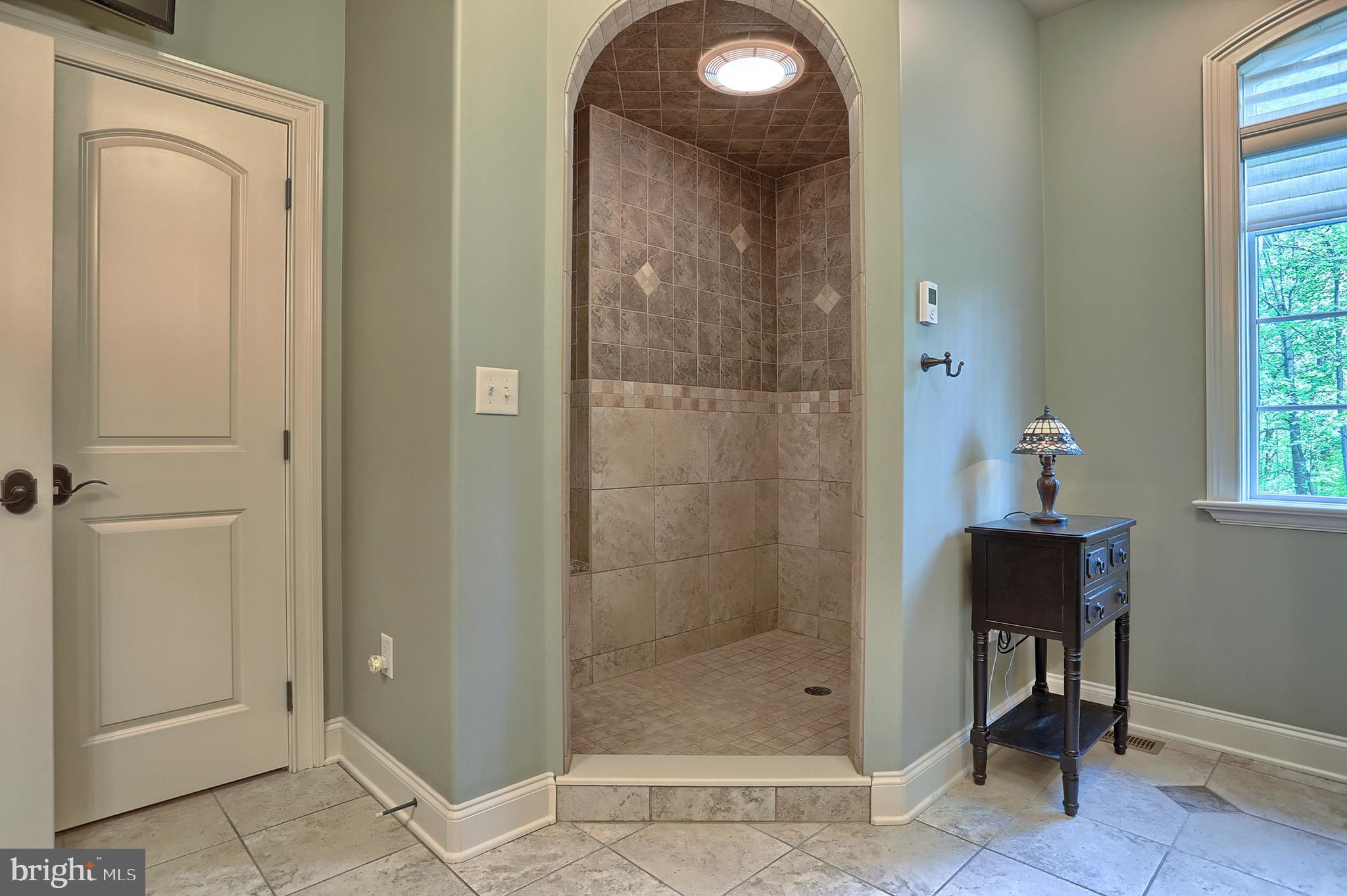 Heated floors in master bath  walk in tile shower