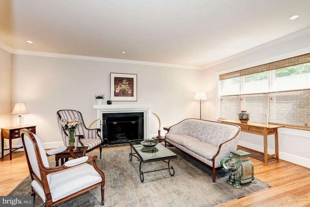 Living room with wood burning fireplace - 4423 SPRINGDALE ST NW, WASHINGTON