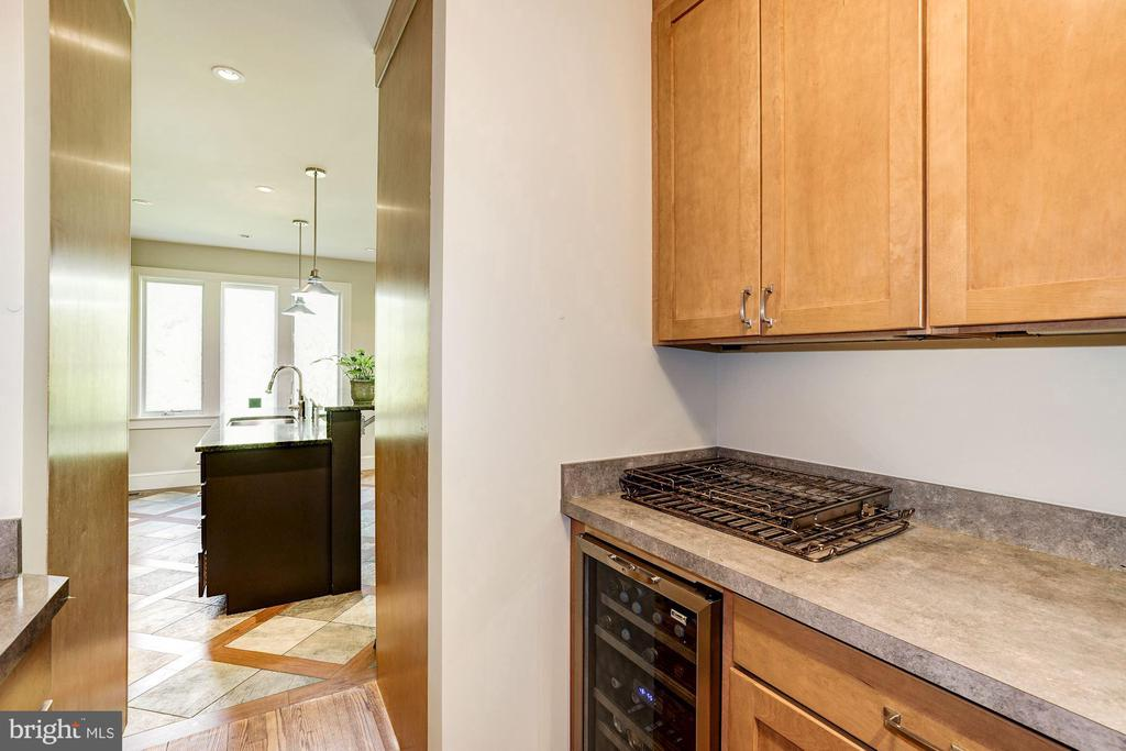 Pantry with wine refrigerator and sink - 4423 SPRINGDALE ST NW, WASHINGTON