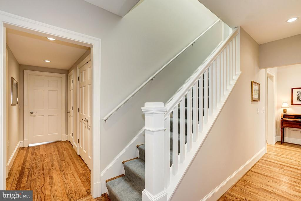 Stairwell with skylight to the second level - 4423 SPRINGDALE ST NW, WASHINGTON