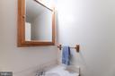 Powder room in foyer - 708 EDWARDS FERRY RD NE, LEESBURG