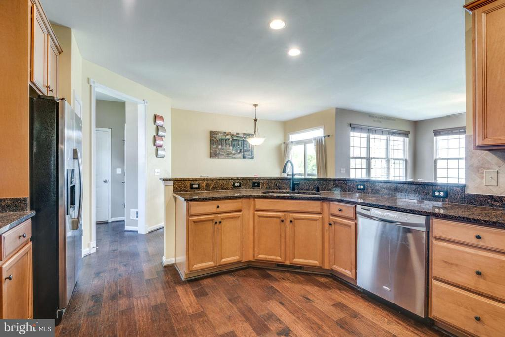 Open to breakfast and family rooms - 43172 FLEUR DR, LEESBURG