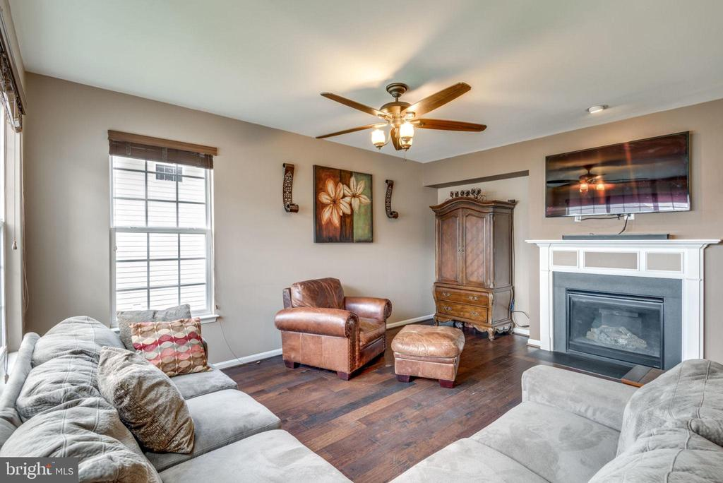 Relax around the gas fireplace - 43172 FLEUR DR, LEESBURG