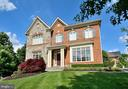 BRICK & STONE FRONT ELEVATION WITH COVERED ENTRY - 4653 AUTUMN GLORY WAY, CHANTILLY