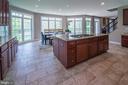New 8' granite slab island Bow windows in kitchen - 17512 FLINT FARM DR, ROUND HILL