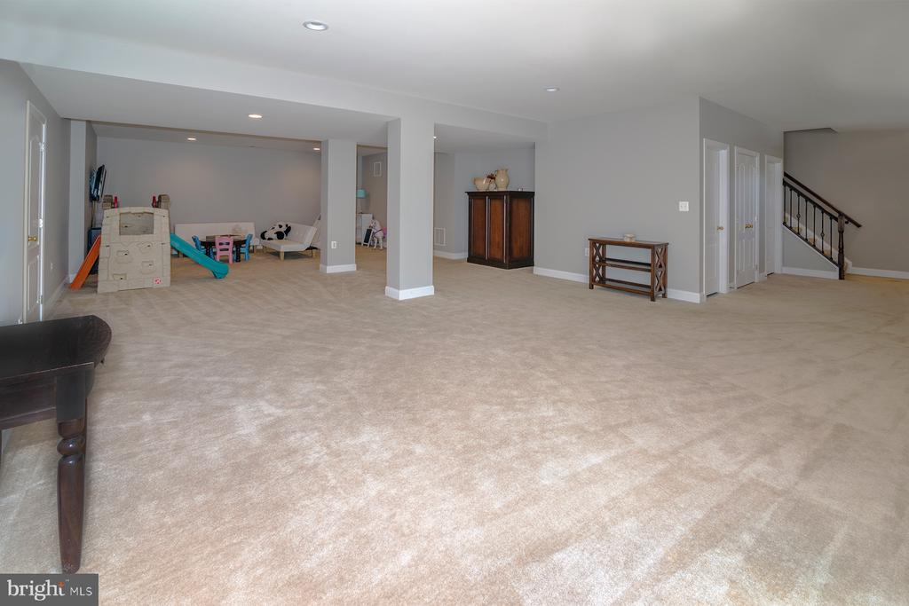 Basement has 3 large unfinished storage rooms - 17512 FLINT FARM DR, ROUND HILL