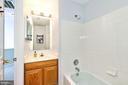 Hall bath with beautiful Carrera marble flooring - 1709 FAIRLEIGH CT NE, LEESBURG