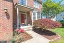 Brick front, portico, lush landscaping - 1709 FAIRLEIGH CT NE, LEESBURG