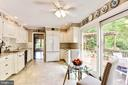 All white kitchen with granite countertops. - 3905 PICARDY CT, ALEXANDRIA