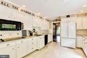 All white kitchen with granite countertops - 3905 PICARDY CT, ALEXANDRIA