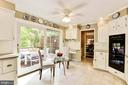 All white kitchen with breakfast nook. - 3905 PICARDY CT, ALEXANDRIA