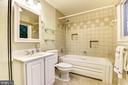 Master bath with two sinks and bathtub. - 3905 PICARDY CT, ALEXANDRIA