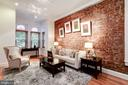 Living Room with exposed brick wall - 304 3RD ST SE, WASHINGTON