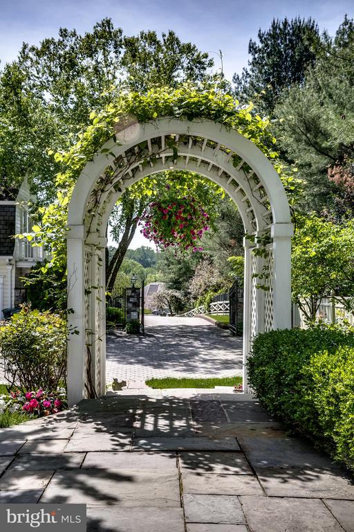 Another beautifully landscaped arch on the grounds - 11408 HIGHLAND FARM CT, POTOMAC