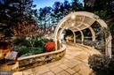 Gorgeous arched trellis with lighting. - 11408 HIGHLAND FARM CT, POTOMAC