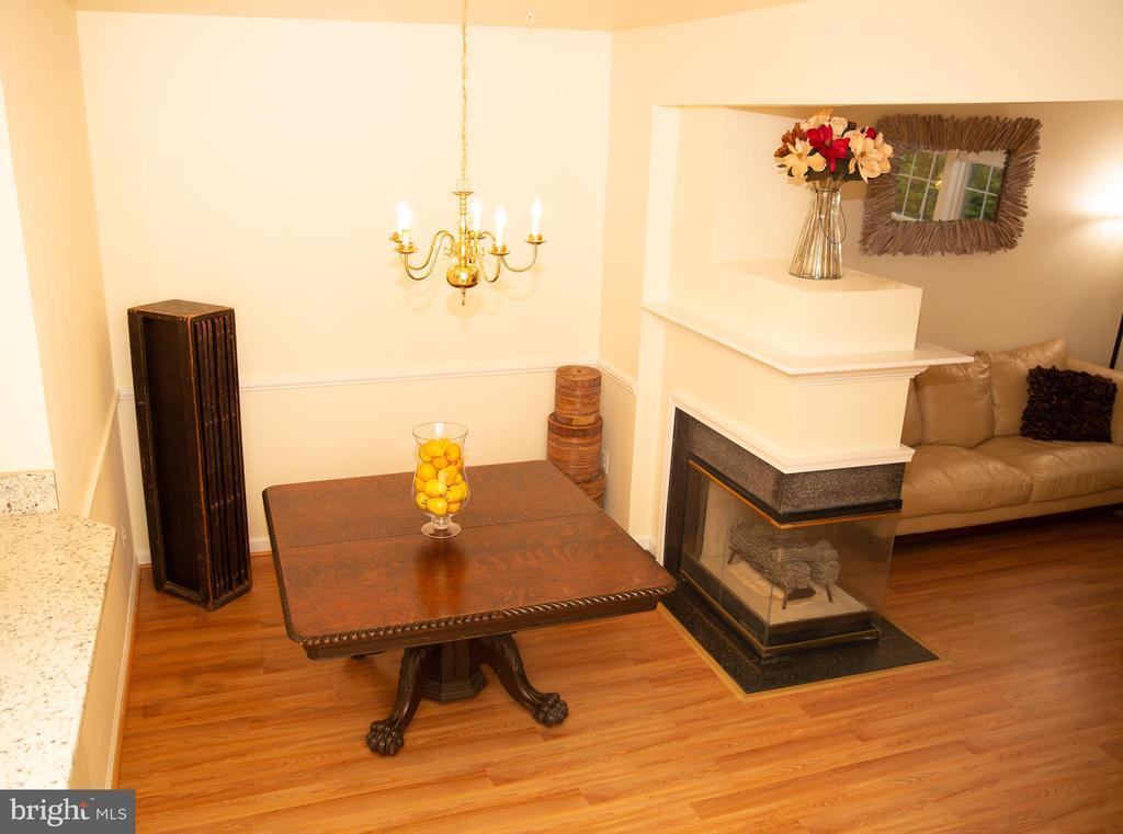 Dining Rm w/ 2 sided Fireplace - 4309 STEVENS BATTLE LN, FAIRFAX