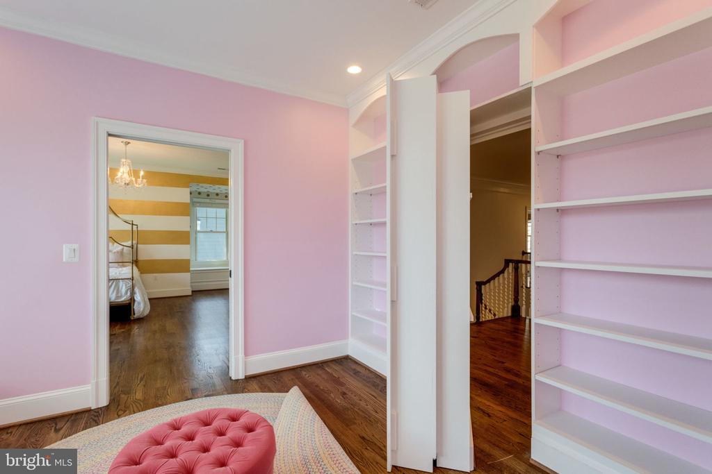 Amazing movable bookcase - 8704 STANDISH RD, ALEXANDRIA