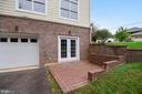 Second patio space on lower level. - 2702 24TH ST N, ARLINGTON