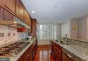 Kitchen with Pantry Closet - 2501 WISCONSIN AVE NW #108, WASHINGTON