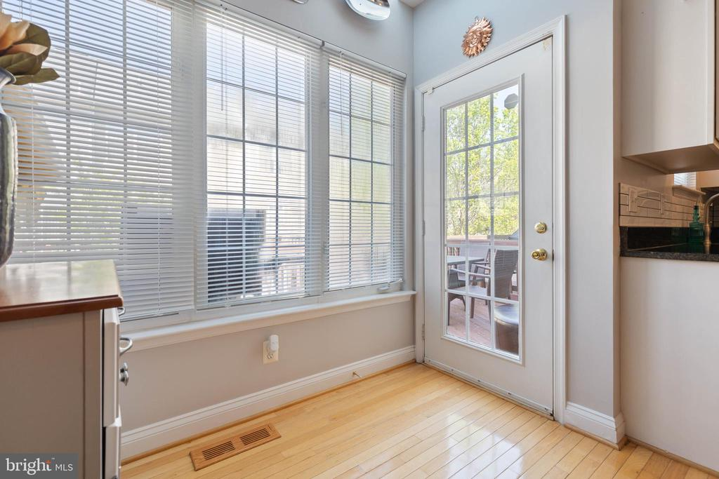 French door leading to deck - 115 MEADOWS LN, ALEXANDRIA