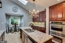 Abundant counters -- island too! - 3703 MACGREGOR CT, ANNANDALE