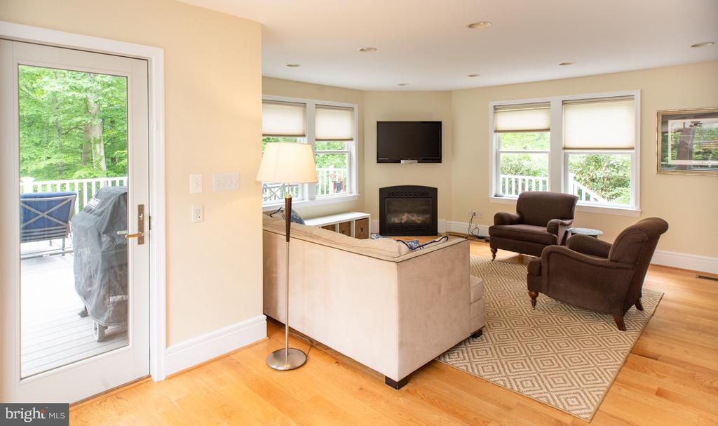 Family Room with Corner Gas Fireplace - 6203 FOXCROFT RD, ALEXANDRIA