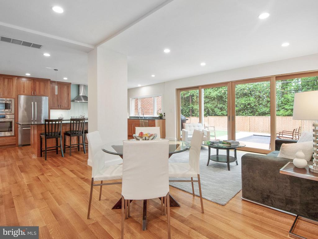 Wall of windows for open, airy feeling - 3927 OLIVER ST, CHEVY CHASE