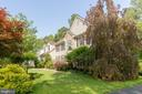 Mature trees and shrubs with seasonal colors - 32 MONUMENT DR, STAFFORD