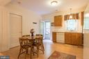 Kitchen/dining in basement with private entrance - 32 MONUMENT DR, STAFFORD