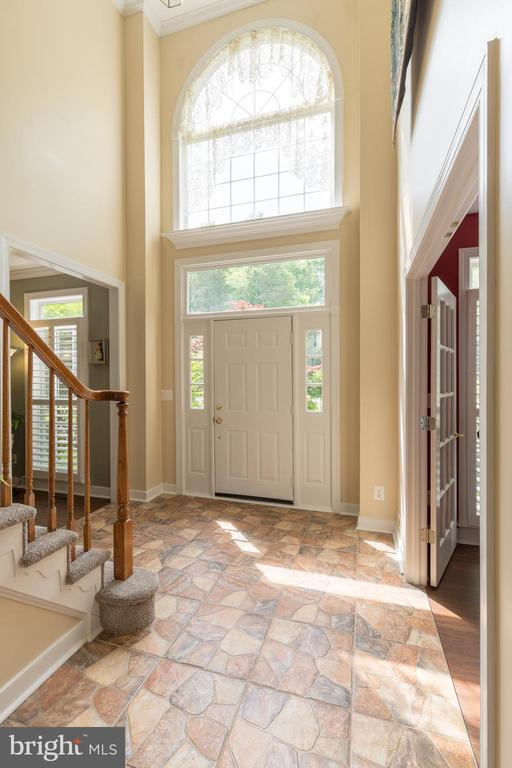 Striking foyer with arched window and  stone floor - 32 MONUMENT DR, STAFFORD