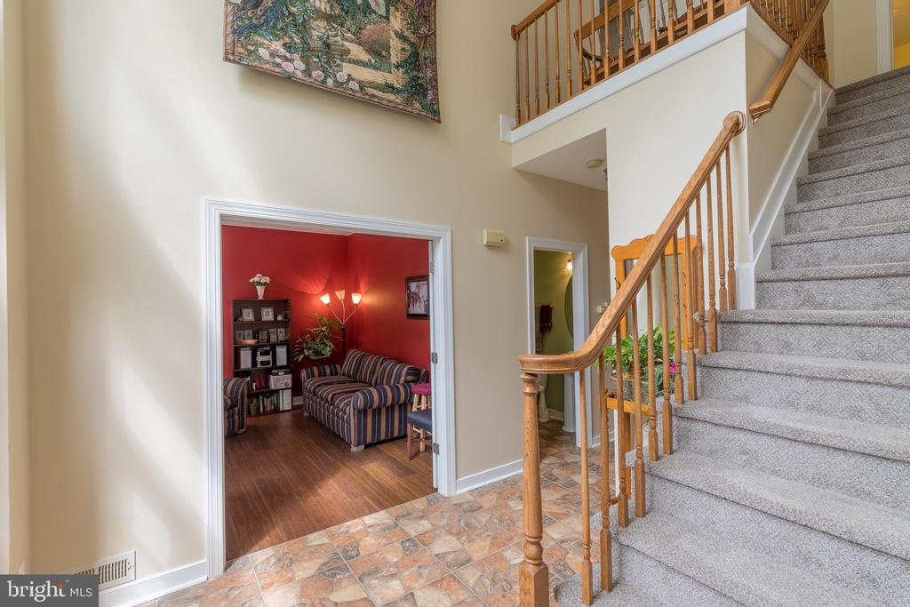Foyer with fresh paint and newly carpeted stairs - 32 MONUMENT DR, STAFFORD