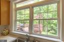 Great view of the lush backyard from kitchen sink - 32 MONUMENT DR, STAFFORD