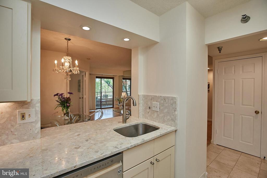 Kitchen remodeled to open to Dining Room - 2400 CLARENDON BLVD #203, ARLINGTON