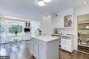 Newly updated kitchen has quartz stone counters - 5508 DEVON RD, BETHESDA